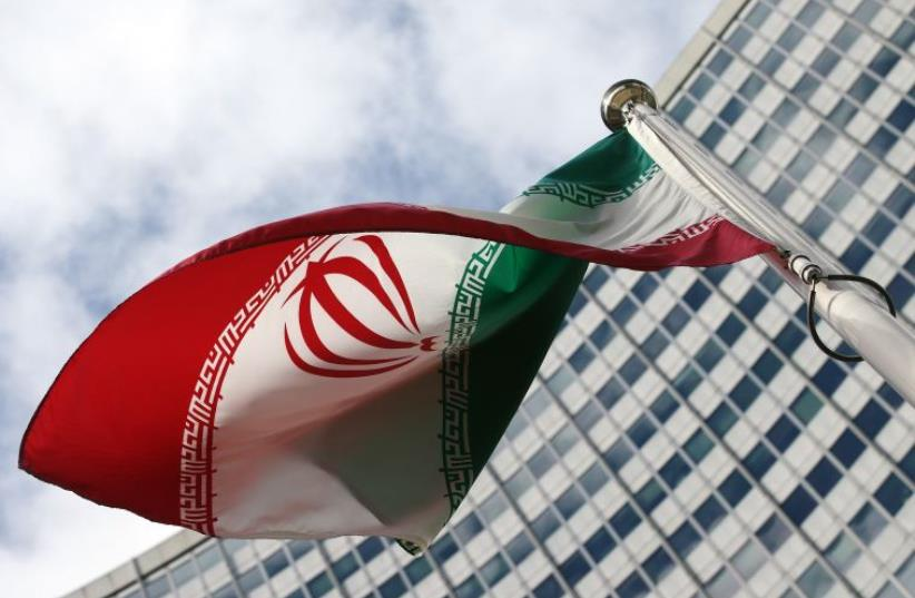 An Iranian flag flutters in front of the United Nations headquarters (photo credit: REUTERS)