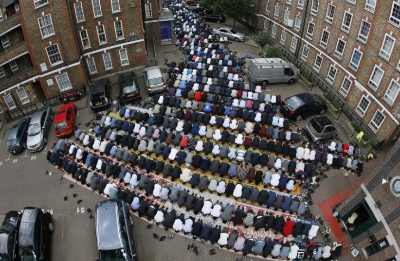 Muslims attend Friday prayers during the second day of Ramadan in east London (photo credit: REUTERS)