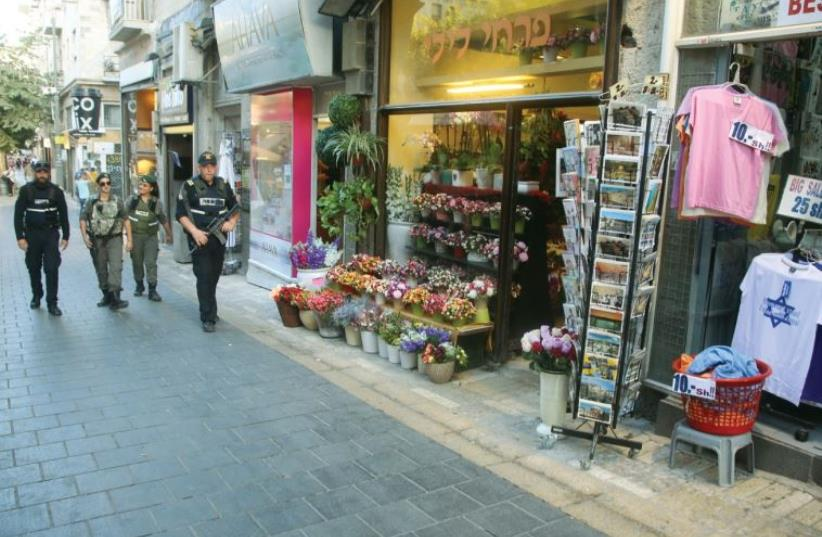 Walking down the normally bustling Ben-Yehuda Street, one finds the heart of Jerusalem uncannily empty (and security out in force) (photo credit: MARC ISRAEL SELLEM/THE JERUSALEM POST)