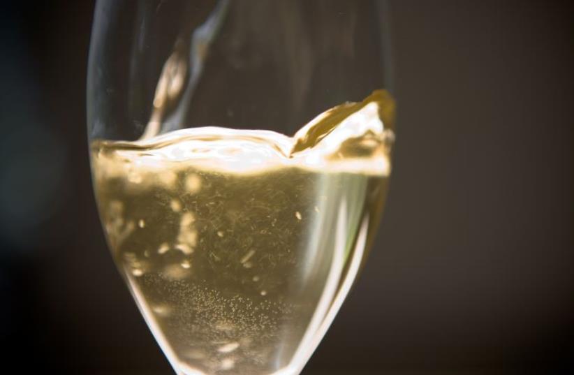 A glass of white wine [Illustrative] (photo credit: INGIMAGE)