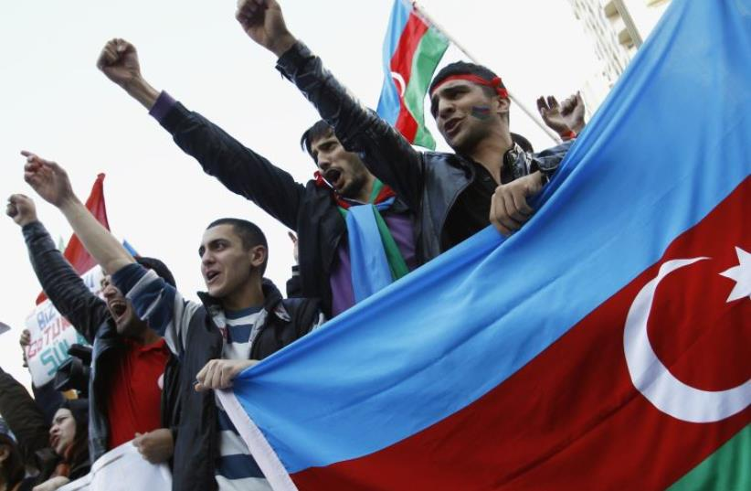 People attend an opposition rally in Baku (photo credit: REUTERS)