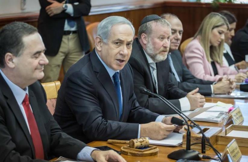 Prime Minister Benjamin Netanyahu adressing cabinet. (photo credit: EMIL SALMAN/POOL)