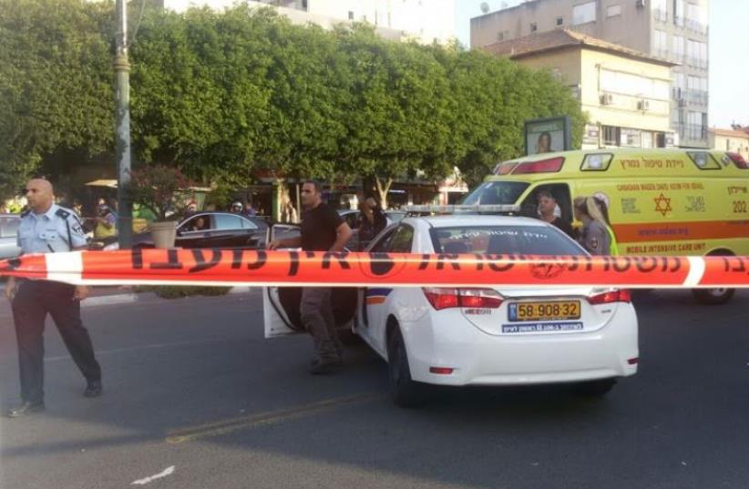 Police car at crime scene (photo credit: SHLOMI)