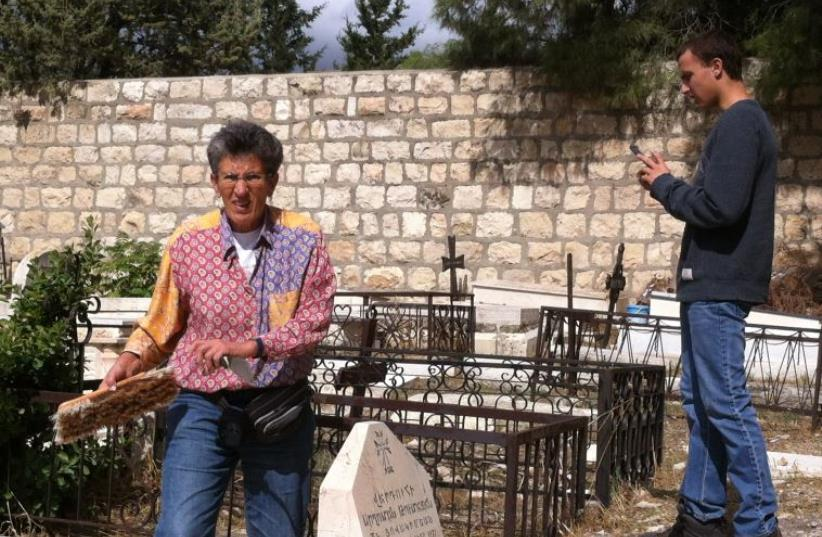 Interfaith delegation cleans Mount Zion graves (photo credit: Courtesy)