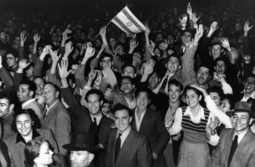 Jews celebrate in the streets of Tel Aviv moments after the United Nations voted on November 29, 1947, to partition Palestine (photo credit: REUTERS)