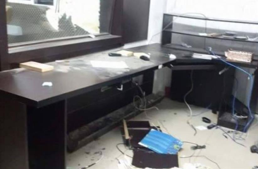 IDF forces raiding Palestinian radio station in Hebron (file) (photo credit: PALESTINIAN MEDIA)