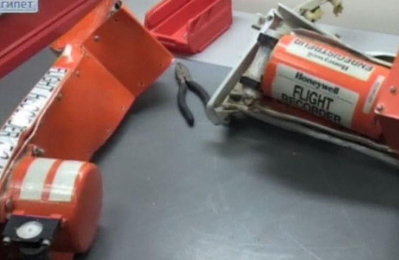 Russian TV shows still of black boxes from plane crashed in Egypt (photo credit: REUTERS)