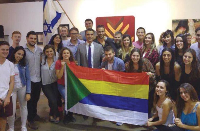 THE DELEGATION poses with Druse and Israeli flags in California. (photo credit: EINAV HALABI)