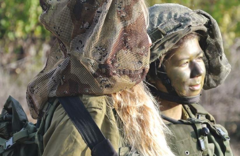 The IDF's new coed combat units are the result of a long struggle for the integration of women into fighting roles in the army (photo credit: SETH J. FRANTZMAN)