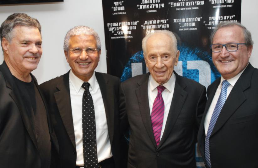 AMOS GITAI (left), Moshe Edery (second left), Shimon Peres and Leon Edery. (photo credit: RAFI DELOYA)