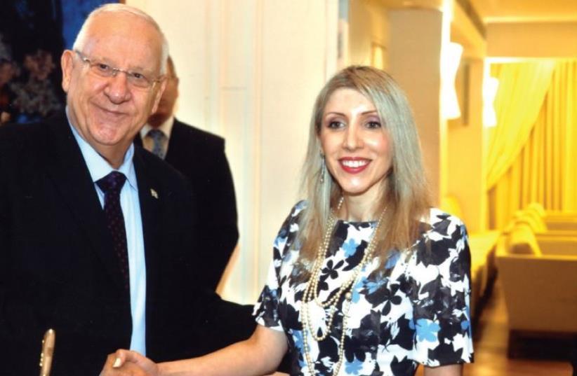 PRESIDENT REUVEN RIVLIN greets Cypriot Ambassador Thessalia Salina Shambos recently. (photo credit: GPO)