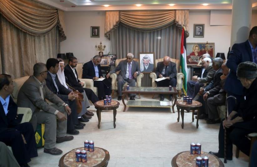 Palestinian politicians gather at the house of late Palestinian leader Yasser Arafat in Gaza City on November 10, 2015 (photo credit: MOHAMMED ABED / AFP)