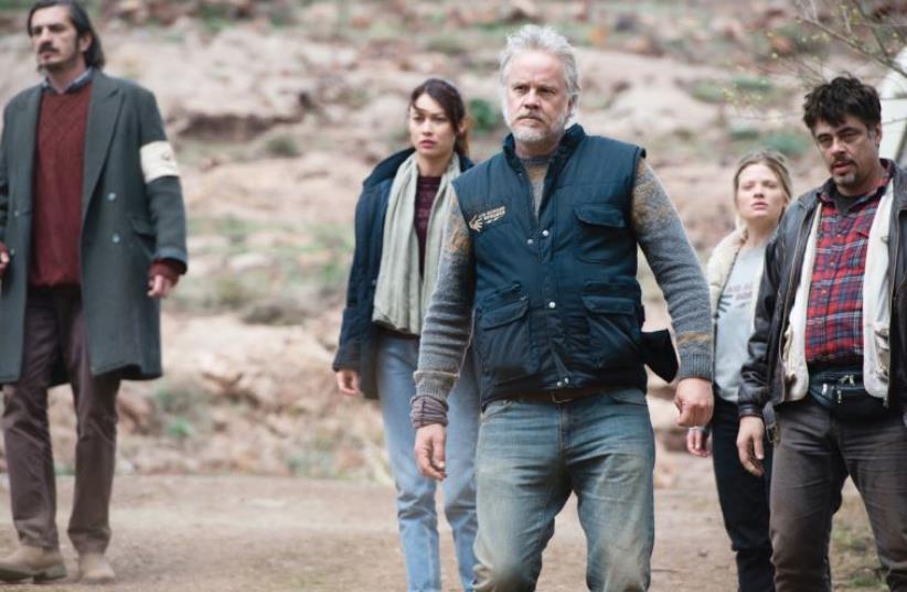 BENICIO DEL TORO (far right) and Tim Robbins (center) star in Fernando León de Aranoa's 'A Perfect Day' which opens this year's Arava Film Festival.  (photo credit: Courtesy)