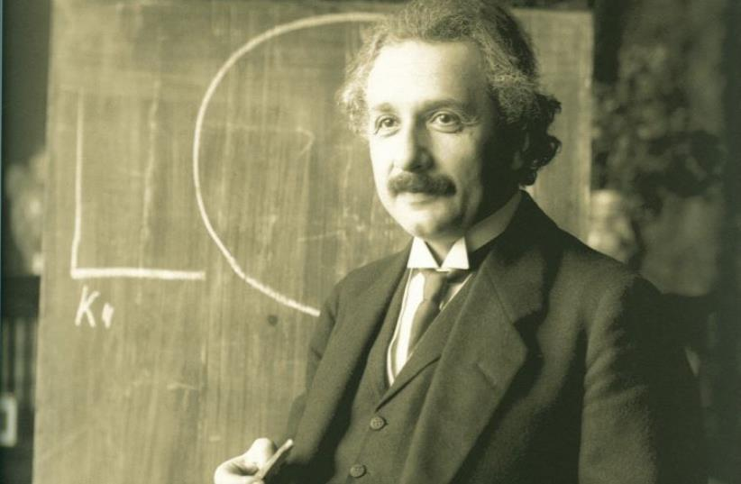 Albert Einstein during a lecture in Vienna in 1921, six years after the scientist announced the completion of his General Theory of Relativity (photo credit: Wikimedia Commons)