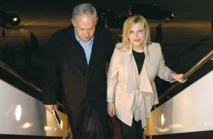 PRIME MINISTER Benjamin Netanyahu and his wife, Sara, board a plane (photo credit: HAIM ZACH/GPO)