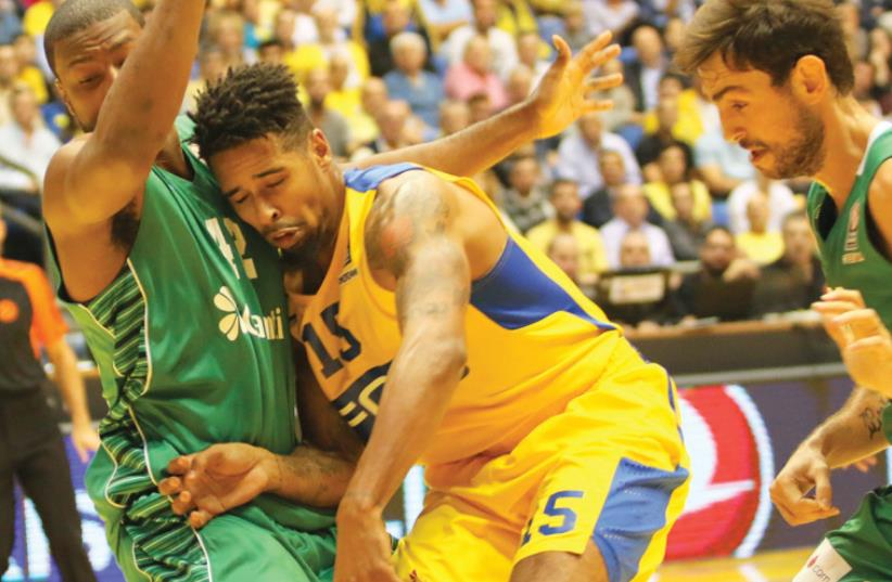 Maccabi Tel Aviv forward Sylven Landesberg (center) couldn't help the team avoid another Euroleague defeat last night, with Darussafaka Istanbul winning 84-73 at Yad Eliyahu Arena in the first game in charge for interim coach Avi Even (inset). (photo credit: ADI AVISHAI)