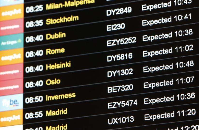 A flight information board is seen at Gatwick Airport in southern England December 7, 2013.  (photo credit: REUTERS)