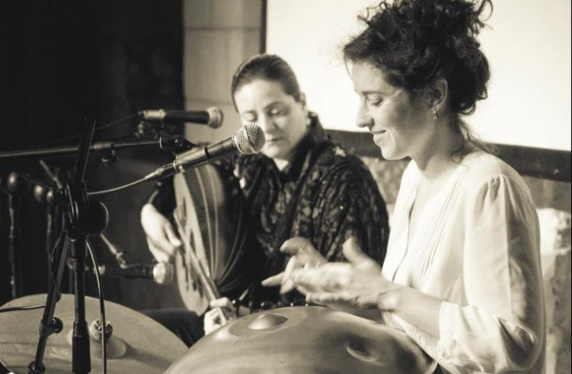CHRISTIAN ARAB oud player Helen Sebilleh (left) joins forces with Israeli percussionist Liron Meyuhas for the Song of the Oud concert. (photo credit: NOAM FINER)