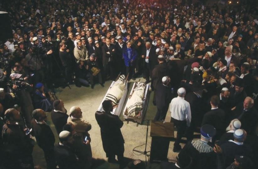 HUNDREDS OF MOURNERS attend the funeral last night in Jerusalem of Ya'akov Litman, 40, and his son, Netanel, 18 (photo credit: MARC ISRAEL SELLEM)