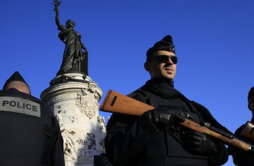 Police stand guard in Place de la Republique following the series of deadly attacks in Paris, November 15, 2015. (photo credit: REUTERS)