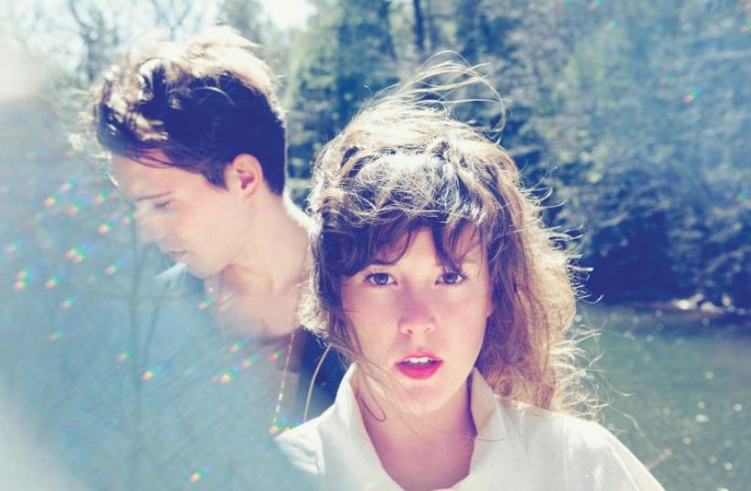 Purity Ring vocalist Megan James (right) with fellow band member Corin Roddick. (photo credit: Courtesy)