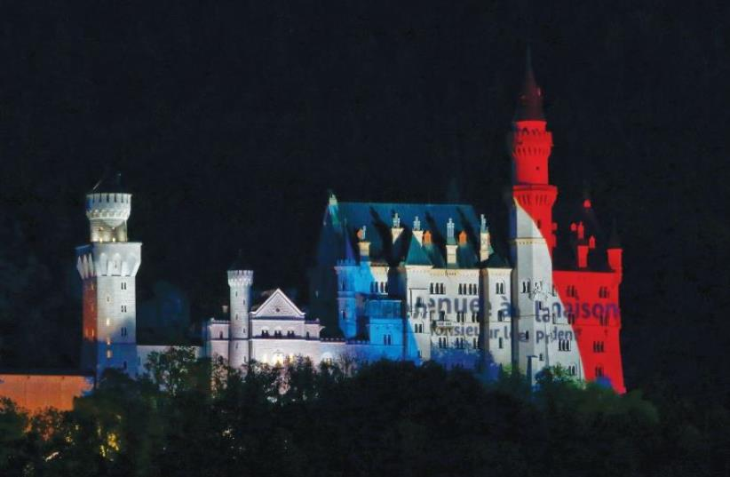 A CASTLE in Bavaria is illuminated in the tri-color. The author argues that terrorism seeks to bring the world back to the dark ages, when castles and human existence was brutish and religious zeal dictated the pattern of violence and life. (photo credit: REUTERS)