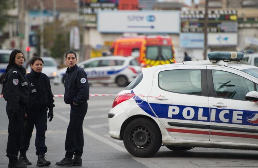 Police. (photo credit: AFP PHOTO/BERTRAND LANGLOIS)