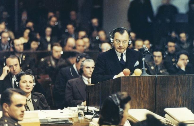 Chief American prosecutor Robert H. Jackson addresses the Nuremberg court on November 20, 1945 (photo credit: Wikimedia Commons)