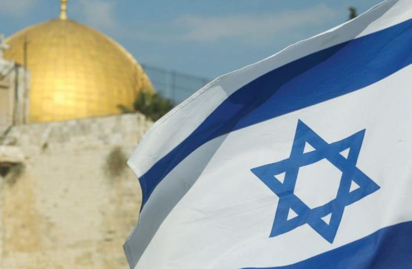 Israeli flag and Temple Mount  (photo credit: MARC ISRAEL SELLEM/THE JERUSALEM POST)