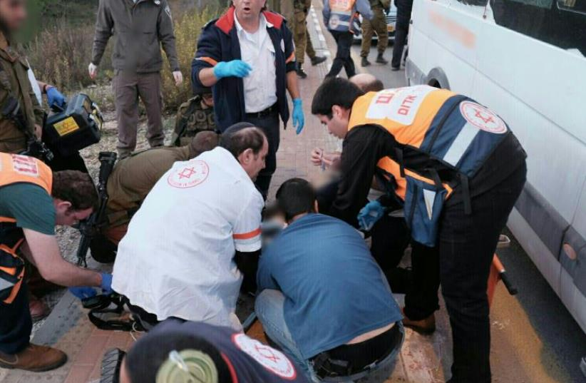 Paramedics treating victims at the scene of a terror attack in Gush Etzion in the West Bank on November 19, 2015 (photo credit: MAGEN DAVID ADOM)