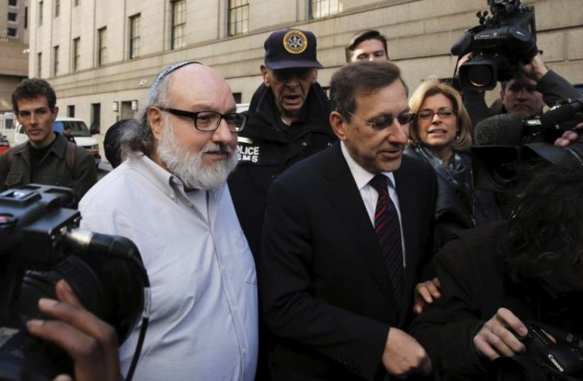 Israeli spy Jonathan Pollard leaves a federal courthouse in New York (photo credit: REUTERS)