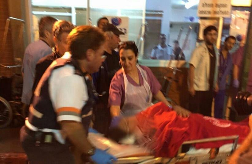 Magen David Adom at scene of Kiryat Gat stabbing, November 21, 2015  (photo credit: MAGEN DAVID ADOM)