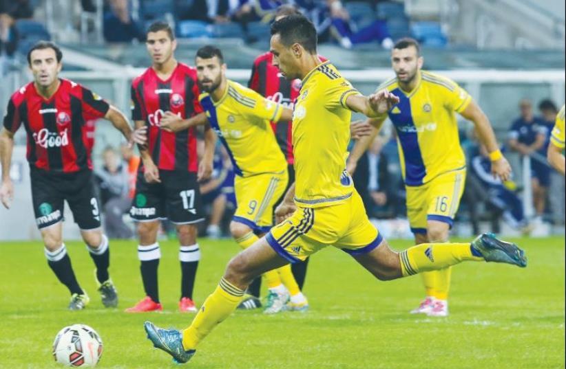 Maccabi Tel Aviv midfielder Eran Zahavi scored his 100th Premier League goal in a 3-0 win at Hapoel Haifa (photo credit: ERAN LUF)