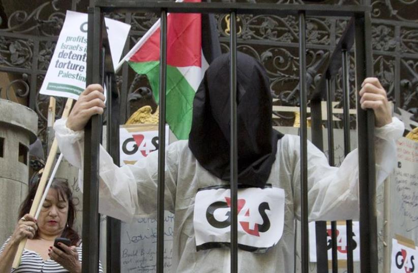 Protesters gather outside G4S security company's annual general meeting in London (photo credit: REUTERS)