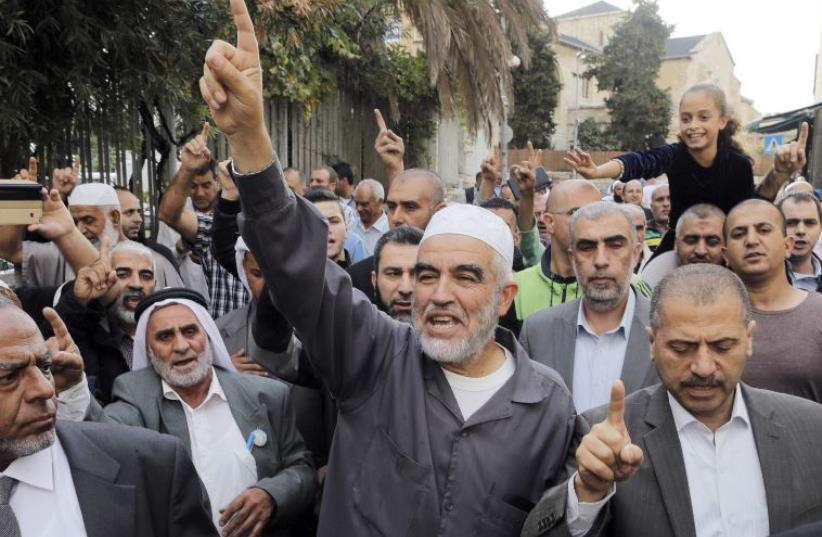 Leader of the northern Islamic Movement Sheikh Raed Salah gestures after leaving the district court in Jerusalem October 27, 2015. (photo credit: AMMAR AWAD/REUTERS)