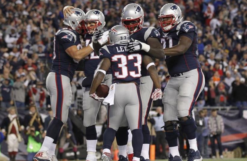 Foxborough, MA, USA; New England Patriots celebrate a touchdown  (photo credit: REUTERS)