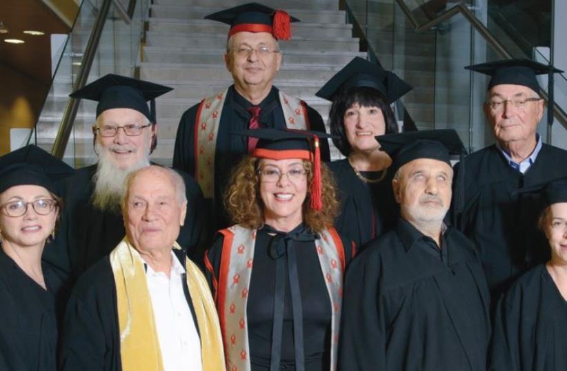 BGU HONOREES (back row, from left) Nobel Prize laureate Prof. Yisrael Aumann, BGU rector Prof. Zvi Hacohen, journalist Judy Siegel-Itzkovich, media personality Yitzhak Livni, (front row, from left) entrepreneur and philanthropist Judith Yovel Recanati, Negev activist Dodik Shoshani, BGU president Ri (photo credit: D MACHLIS/ BGU)