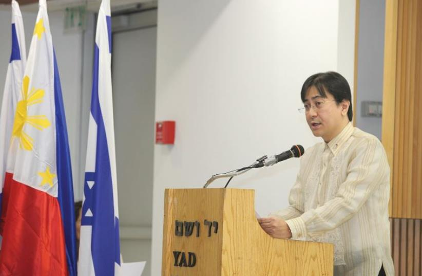 PHILIPPINE AMBASSADOR to Israel Nathaniel Imperial delivers an address at a Yad Vashem   (photo credit: ISAAC HARARI)