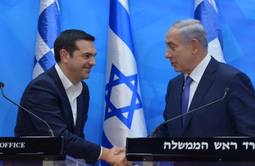 Prime Minister Benjamin Netanyahu (L) and Greek Prime Minister Alexis Tsipras, November 25, 2015 (photo credit: KOBY GIDEON/GPO)