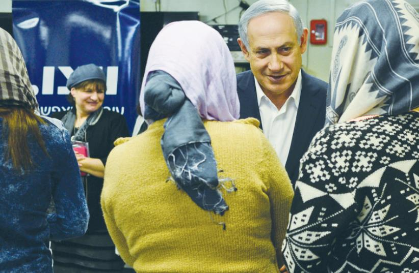 PRIME MINISTER Benjamin Netanyahu meets with women living at a WIZO and government sponsored shelter for victims of domestic violence, during a tour marking International Day for the Elimination of Violence Against Women. (photo credit: KOBY GIDEON/GPO)