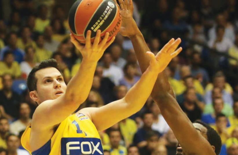 Maccabi Tel Aviv captain Guy Pnini will aim to build on his encouraging 15-point performance in the BSL win over Maccabi Haifa when the yellow-and-blue visits Unicaja Malaga tonight in Euroleague action. (photo credit: ADI AVISHAI)