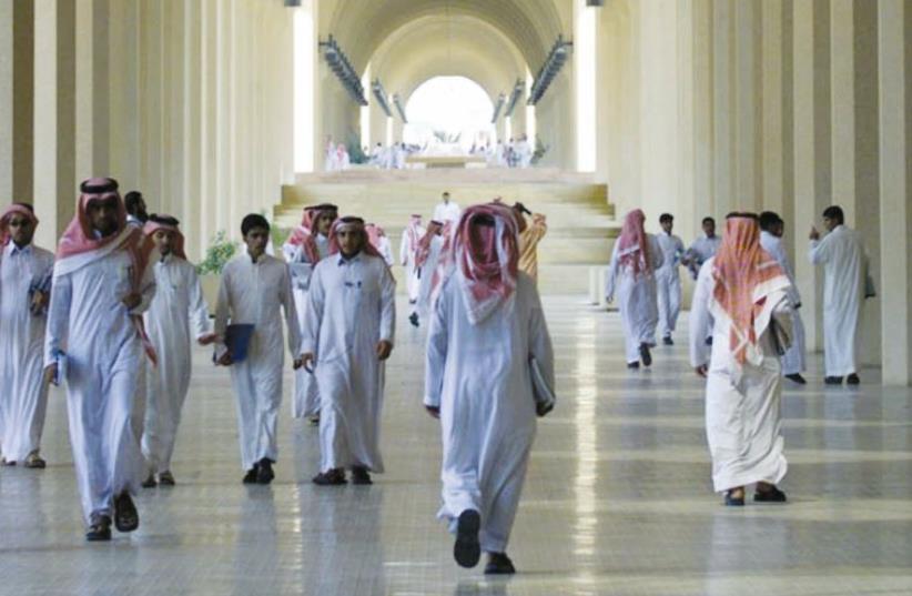 Saudi men walk through the halls of King Saud University in Riyadh (photo credit: MAARIV HAMUSAF)