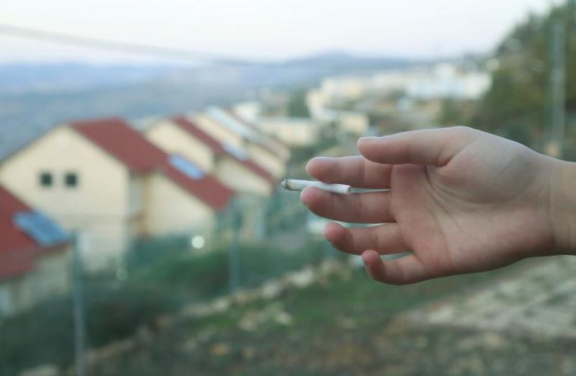 Smoking (photo credit: MARC ISRAEL SELLEM/THE JERUSALEM POST)