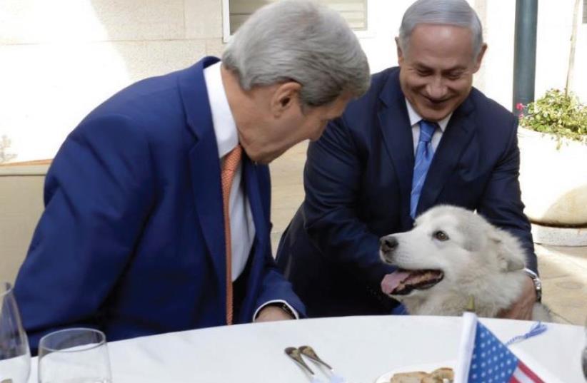 US SECRETARY of State John Kerry (L) and Prime Minister Benjamin Netanyahu lavish attention on Kaya, the prime minister's dog (photo credit: US STATE DEPARTMENT)