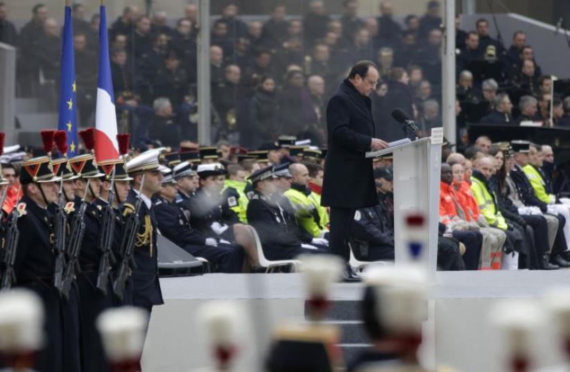 France pays tribute to fallen victims of terror attacks in Paris (photo credit: REUTERS)