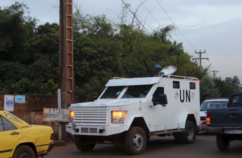 A UN armored vehicle patrols in Bamako, Mali, November 23, 2015.  (photo credit: REUTERS)