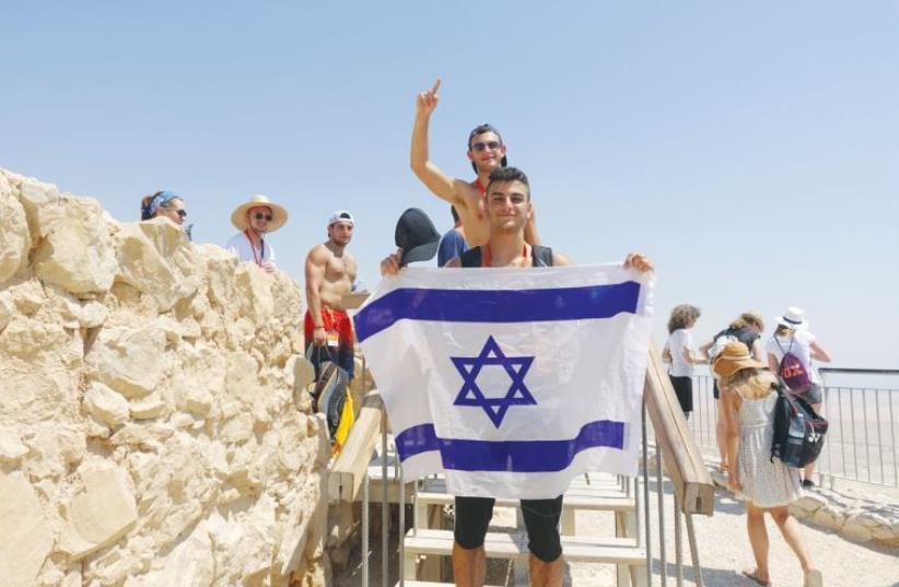 Birthright participants pose on top of Masada. (photo credit: TAGLIT-BIRTHRIGHT)