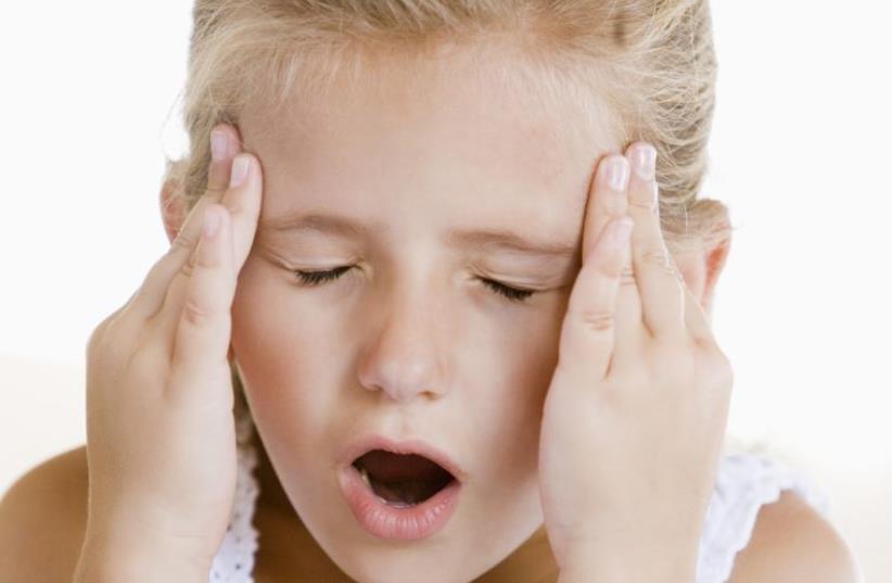 Girl with a headache (photo credit: INGIMAGE)