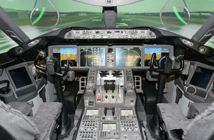 The Boeing 787 Dreamliner Engineering flight deck simulator is shown during a media tour of Boeing Co (photo credit: REUTERS)
