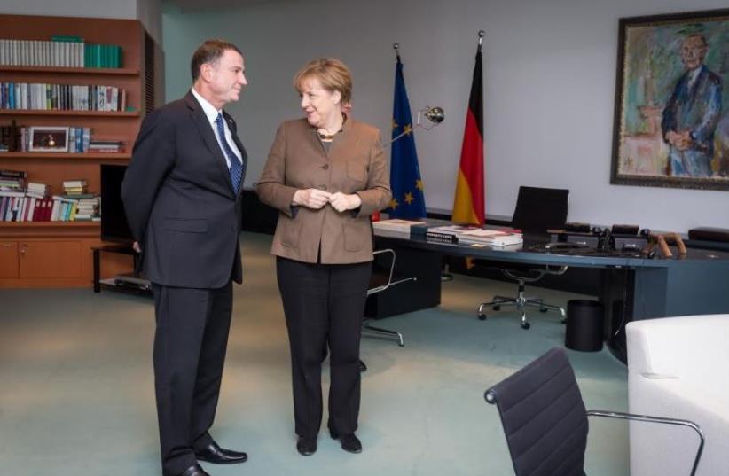 German Chancellor Angela Merkel (R) and Knesset Speaker Yuli Edelstein meet in her office in Berlin (photo credit: BOAZ ARAD)